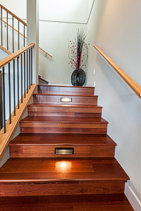 Extra wide stairs with inset lights are a beautiful addition for the owners, and for aging parents who visit frequently from Calgary. Photograph by: Debra Brash