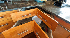Corner drawers were custom made by Gillingham Cabinets, along with all the other kitchen and bathroom cabinets and built-ins. Photograph by: Debra Brash